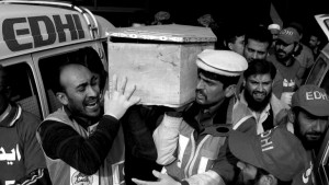 2.Rescue workers and family members carry the coffin of a student killed during an attack by Taliban gunmen on the Army Public School in Peshawar. PHOTO: REUTERS