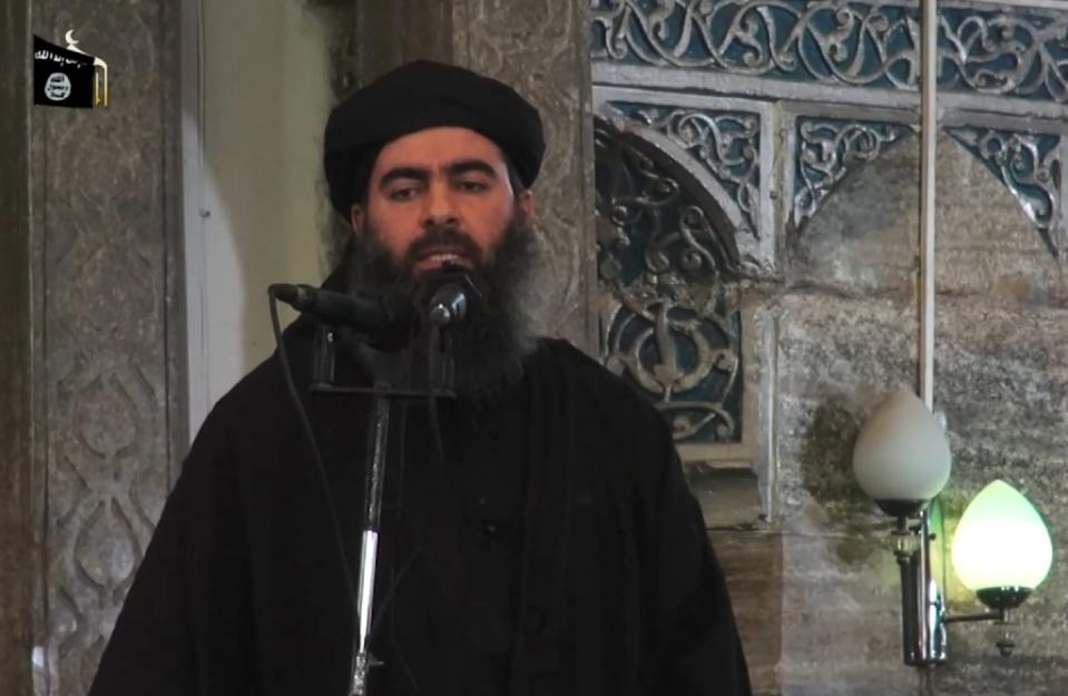 Islamic State group leader Abu Bakr al-Baghdadi is shown addressing worshippers in the militant-held Iraqi city of Mosul in this grab from a video by jihadist Al-Furqan Media on July 5, 2014 PHOTO: AFP