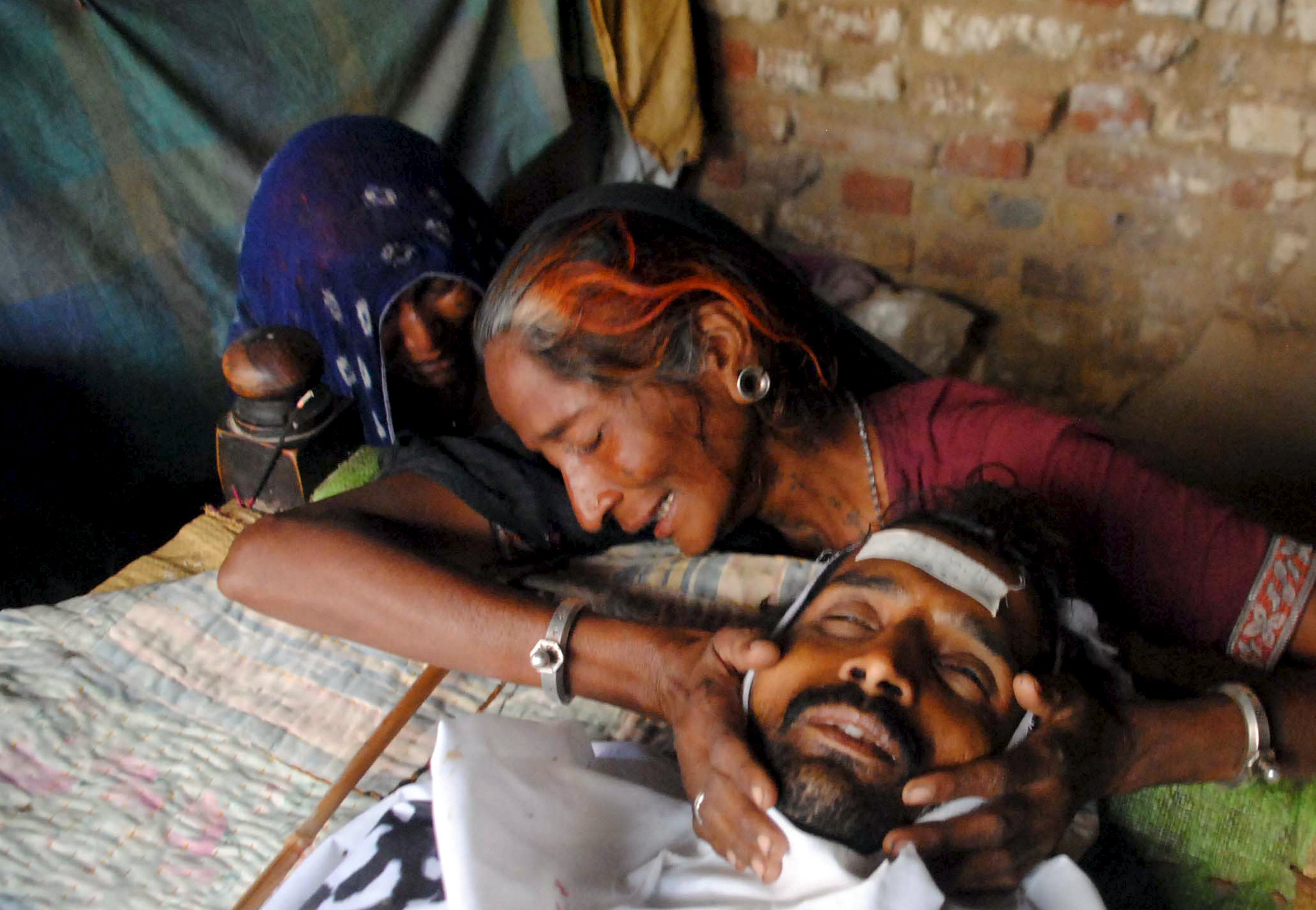 Relatives mourn a man who died after consuming bootleg alcohol in Tando Mohammad Khan in March. PHOTO: REUTERS